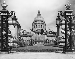 Flags of the United Nations wave in the courtyard of San Francisco City Hall, 1945. Dag Hammarskjöld Library / Research Guides / UN Documentation.