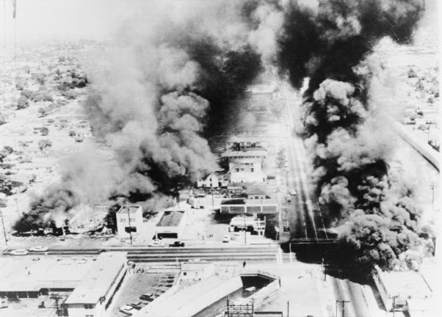 Aerial view of burning buildings, August 13, 1965; Library of Congress