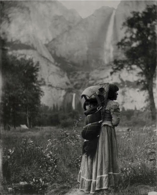 J. T. Boysen, Susie McGowan, of the Paiute tribe, with Daughter Sadie in Cradleboard in Yosemite Valley, c. 1901; courtesy of National Park Service/Yosemite National Park/Yosemite Research Library An iconic image of early Yosemite Native American life, this photograph of a mother and child from the Paiute tribe features Yosemite Upper and Lower Falls in the background.